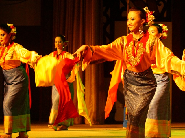 Cultural show performed by dancers wearing traditional clothes