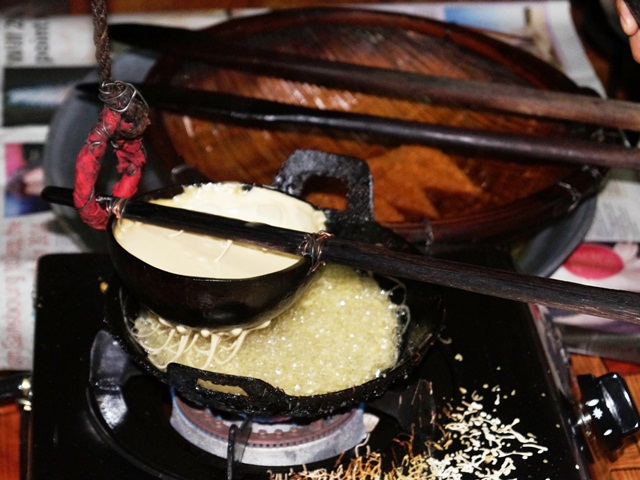 Rice cookie being prepared in a small wok
